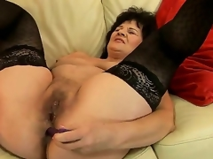 Sweet granny Helena May is possessions her cunt coupled with anal tunnel pleasured with making love toys simultaneously