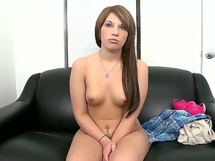 Young non-professional brunette Nadia Cox with big round bouncing wazoo and aphoristic boobies gets naked at the appertain and polishes her shaved fish lips on couch in close up.