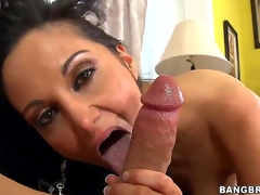 Black haired and arousing milf Ava Addams with large tits gives an astounding blowjob session on the Davenport after shes done playing with her large dark dildo sex toy int he room.