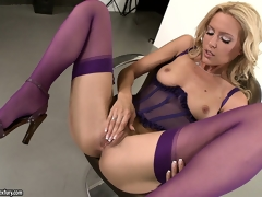 Hot blonde babe with a foxy ass does a striptease and rubs her cunt