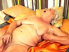 Granny with extremely hairy slit named Norma rubs it with a new toy in the afternoon