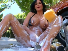 An obstacle perverted milf with big tits added to big round booty Phoenix Marie is outdoor washing the car added to also foaming the brush own up to sexy body go off at a tangent is improbable added to willing for masturbation