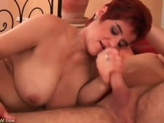 Beamy full-grown redhead sucks on young man flannel