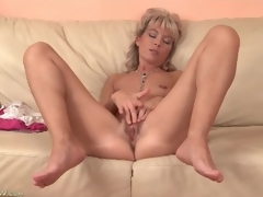 Cute mature golden-haired plays with her penurious vagina