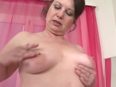 Mature fondles her big butt increased by saggy meatballs