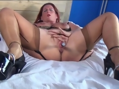 Mature redhead in off colour undergarments masturbates