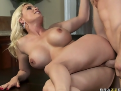 The stacked blonde lies on the provisions and receives her pink cunt pounded deep
