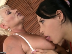 Old plus youthful lesbian babes take a bubble bathroom plus take yon with the tongue some bald pussy