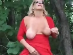 Horny mature bitch fingering in wood