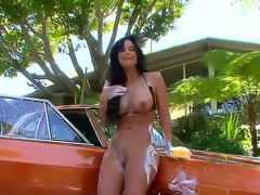 Unbelievably fuckable brunette milf Phoenix Marie is washing a car completely naked and relative to the process her wobblers and arse get all soaped up, looking solitary awesome.