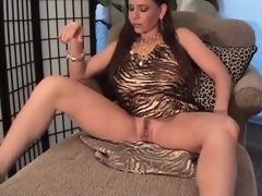 Breasty milf in slutty suit pumps her pussy