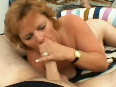 Sexually excited blond grandmother Megan sucking a big young prick with lasciviousness