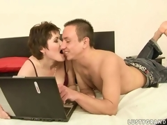 Sexy grown-up woman and a horny dude making love