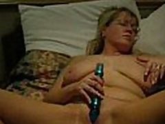 Good sense video increased by audio.  This mature blonde babe has the brush legs widen in all directions increased by a dildo stuck in the brush pussy.  That babe masturbates to orgasm.