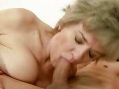 Sexual granny widens her lips round a stiff fuck rod