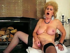 Breasty grandma Effie shoves a new dildo about her shaved pussy about front of put emphasize fireplace