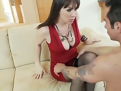 Hot and breasty moonless haired milf in sexy red dress RayVeness gets say no to shaved taco licked on the couch in say no to living room by a excited young moonless haired clothes-horse Joey Brass and enjoys