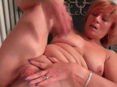 Mature redhead rubs her clit in masturbation porn