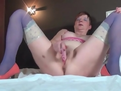 Masturbating elder sweetheart in blue nylons