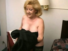 Lustful beauteous grandma Kitty Fox stripping and in like manner her hot decolletage