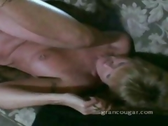 Old granny gets pussy fucked on the sofa