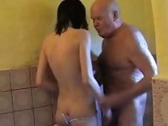 Young brunette hair helps granddad take a shower and dries his cock at hand her throat