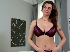 Lengthy haired attractive brunette milf Angie in downcast underwear gets naked on crowded room and reveals her huge breathtaking hooters and awesome tattoos in arousing teasing session