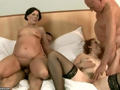 Margo T and Eodit are two sexually excited grannies go off at a tangent get their mouths and dripping soiled pussies fucked side by side. Two fuck hungry oldies do it on a king size ottoman in steamy foursome action!