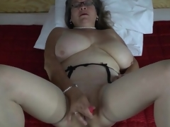 Pearls and glasses on high masturbating adult
