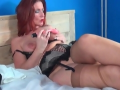 Mature redhead models lingerie and masturbates