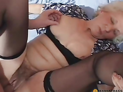 A woman with a hairy pussy fucked on the sofa