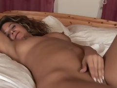 MILF Emanuelle masturbating in their way bed